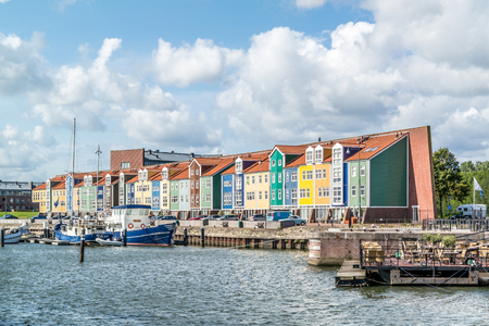 HELLEVOETSLUIS, NETHERLANDS - AUG 25, 2015: Row of colourful wharf houses in the city of Hellevoetsluis, Netherlands
