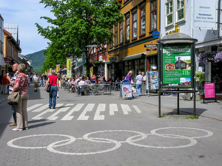 olympic rings: Lillehammer, Norway - June 16, 2010: Main shopping street with Olympic rings on the ground in the city centre of Lillehammer in Oppland
