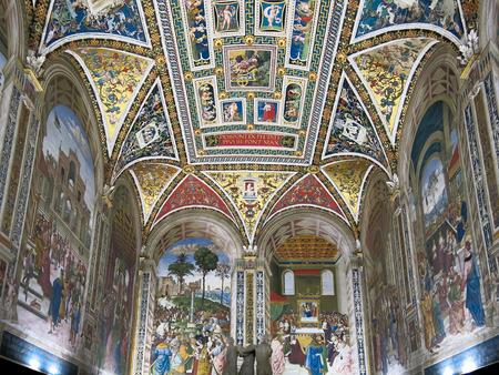 Bernardino: SIENA, ITALY - JULY 27, 2013: Interior of Duomo di Siena or Siena Cathedral.  Piccolomini Library with frescoes painted by Umbrian Bernardino di Betto, called Pinturicchio Editorial