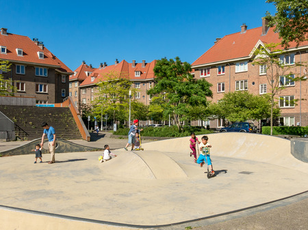 AMSTERDAM, NETHERLANDS - JUNE 6, 2015: Children playing on Zaandammerplein square in residential neighborhood called Spaarndammerbuurt in west district of the city of Amsterdam, Netherlands