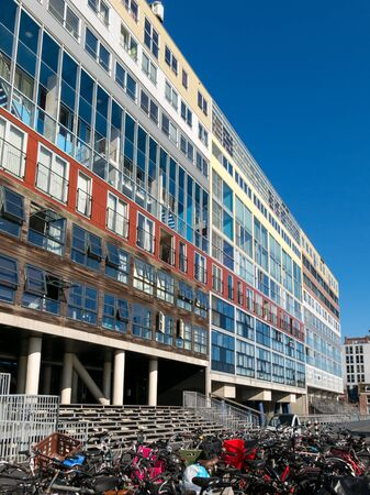 social apartment: AMSTERDAM, NETHERLANDS - JUNE 6, 2015: Modern colorful social housing apartment building Silodam alongside IJ in Amsterdam, Netherlands