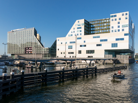 AMSTERDAM, NETHERLANDS - JUNE 6, 2015: Hotel and court buildings on IJdock peninsula in Amsterdam City, Netherlands