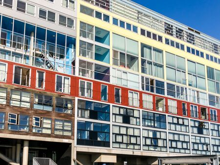 AMSTERDAM, NETHERLANDS - JUNE 6, 2015: Modern colorful social housing apartment building Silodam alongside IJ in Amsterdam, Netherlands