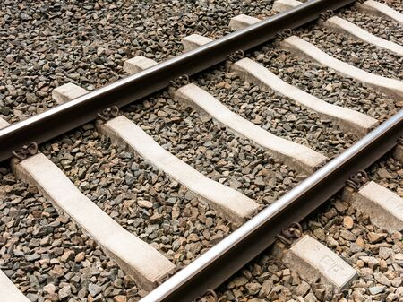 ballast: Detail of railroad track with concrete railway ties and crushed stone for ballast, Netherlands