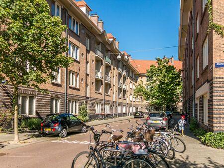 residential neighborhood: AMSTERDAM, NETHERLANDS - JUNE 6, 2015: Corner of Houtrijkstraat and Zaandammerplein in residential neighborhood called Spaarndammerbuurt in west district of the city of Amsterdam, Netherlands