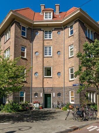 residential neighborhood: AMSTERDAM, NETHERLANDS - JUNE 6, 2015: Zaandammerplein in residential neighborhood called Spaarndammerbuurt in west district of the city of Amsterdam, Netherlands Editorial
