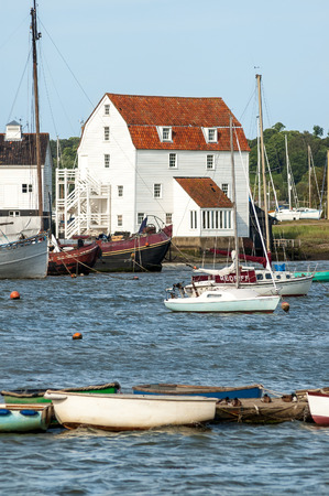 woodbridge: WOODBRIDGE, ENGLAND - JUNE 20, 2006: Woodbridge Tide Mill and yachts on River Deben in  Suffolk, East Anglia, England, United Kingdom Editorial