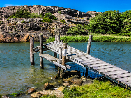 ruinous: Old jetty at the southwest coast of Sweden