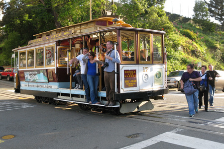 san francisco: Tourists and commuters, passengers on cable car at Van Ness Avenue, Russian Hill, San Francisco, California, USA Editorial