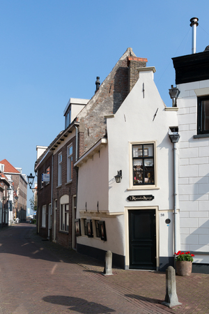 streetscene: Streetscene with very small house in the city centre of Kampen, Overijssel, Netherlands Editorial