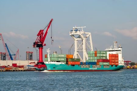 schiedam: Container ship and cranes in Wiltonhaven, Schiedam, Port of Rotterdam, the Netherlands
