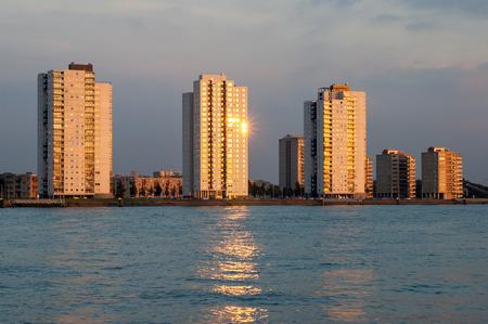 alongside: Residential skyscrapers alongside New Meuse River in Rotterdam, the Netherlands