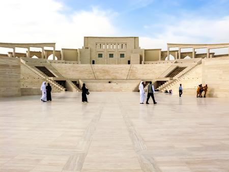 DOHA, QATAR - DEC 24, 2010: People in amphitheatre in Katara Cultural Village, Doha, Qatar