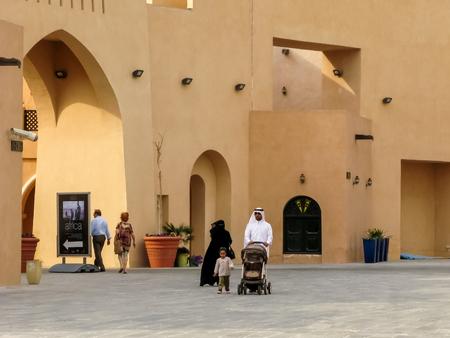 DOHA, QATAR, DEC 24, 2010: People walking in Katara Cultural Village, Doha, Qatar Editorial
