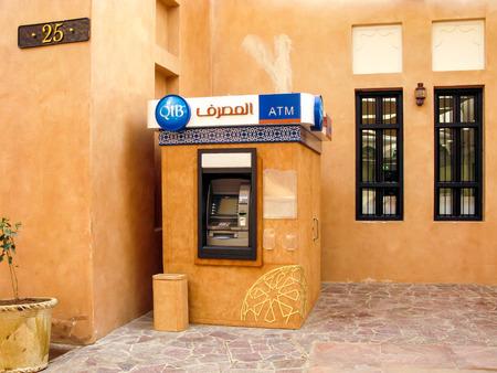 bancomat: DOHA, QATAR - DEC 24, 2010: ATM cashpoint in Katara Cultural Village, Doha, Qatar Editorial