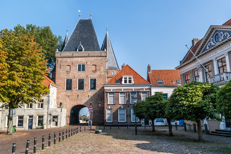 Koornmarkt square and gate in the old city centre of Kampen, Overijssel, Netherlands