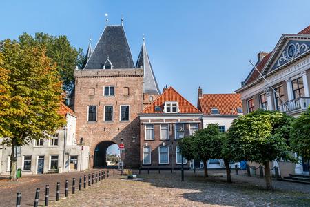 Koornmarkt square and gate in the old city centre of Kampen, Overijssel, Netherlands