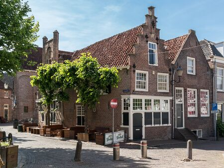 Old medieval houses and cafe at Groenmarkt Square in the city of Amersfoort, Netherlands