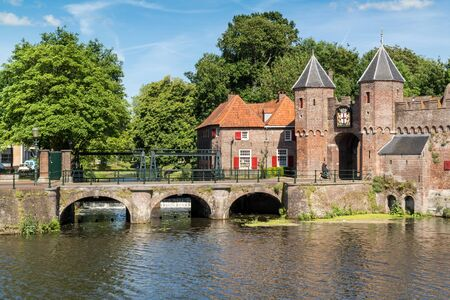 eem: Medieval fortress city wall gate Koppelpoort and Eem River in the city of Amersfoort, Netherlands