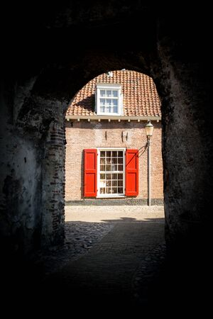 Medieval fortress city wall gate Koppelpoort and Eem River in the city of Amersfoort - tourist destination near Amsterdam, Netherlands