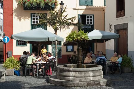 canarian: People enjoying on outdoor terrace of cafe on Placeta de Borrero in Santa Cruz on the island La Palma, Canary Islands, Spain Editorial