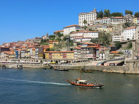 alongside: Ribeira District and quay alongside Douro River, Porto, Portugal