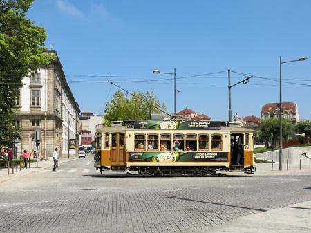tramcar: PORTO, PORTUGAL - AUG 21, 2013: Vintage tramcar of heritage tram line system in the city of Porto, Portugal