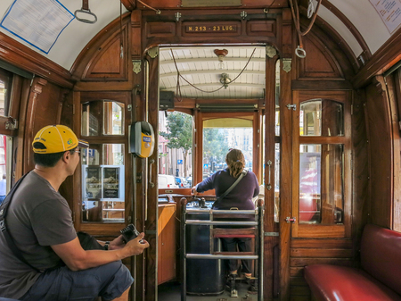 tramcar: PORTO, PORTUGAL - AUG 22, 2013: Driver and tourist inside vintage tramcar of heritage tram line in Porto city, Portugal