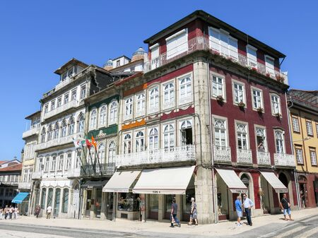 guimaraes: Traditional old houses on Largo do Toural in the city of Guimaraes in Portugal Editorial