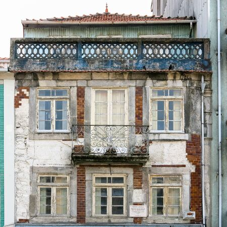 Facade of old deserted house in the city centre of Porto, Portugal