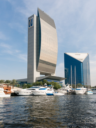 central chamber: Buildings of the National Bank of Dubai and the Chamber of Commerce, DCCI, in Rigga Al Buteen Central Business District Deira, the Creek in Dubai, United Arab Emirates Editorial