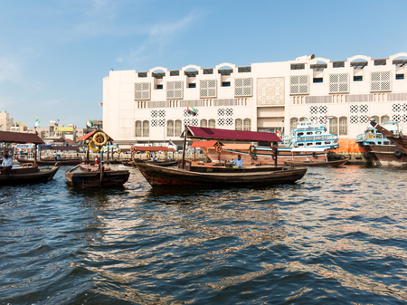 bur dubai: Wooden boats called abra water taxis for public transport across the Creek from Deira to Bur Dubai in Dubai, United Arab Emirates