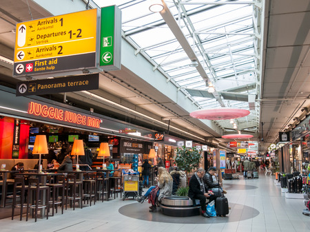 People waiting in Schiphol Plaza shopping center at Schiphol Amsterdam Airport, Netherlands