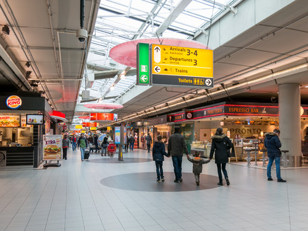 People in Plaza shopping area at Schiphol Amsterdam Airport, Netherlands Stock Photo - 48399253