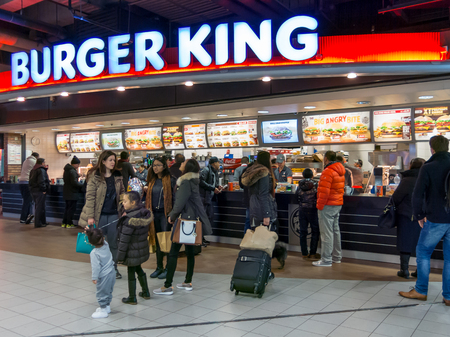 schiphol: People at Burger Kings in Schiphol Plaza at Amsterdam Airport, Netherlands