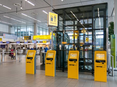 schiphol: Check-in area in departure terminal of Schiphol Amsterdam Airport, Netherlands