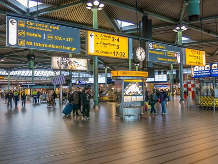 schiphol: Information signs and people in train terminal of Schiphol Amsterdam Airport, Netherlands