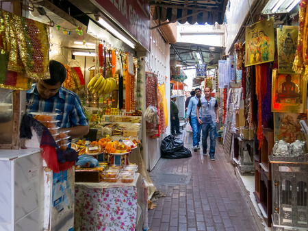 suq: One of the narrow streets in the ancient covered textile souq Bur Dubai in the old city centre of Dubai, United Arab Emirates