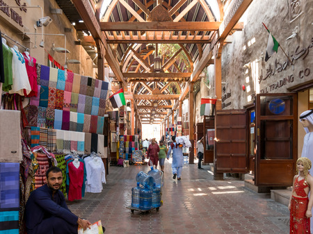 bur dubai: Shops and vendors in the ancient covered textile souq Bur Dubai in the old city centre of Dubai, United Arab Emirates