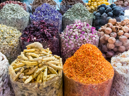 suq: Assortment of spices  displayed in bags in the famous Spice Souk in Deira area of Dubai, United Arab Emirates Stock Photo