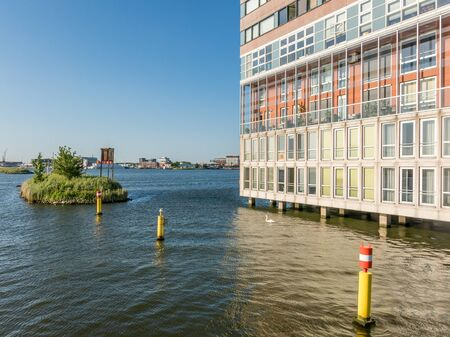 social apartment: Modern social housing apartment building Silodam alongside IJ in Amsterdam, Netherlands
