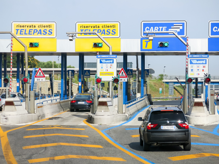 Cars at Autostrade motorway, highway Toll in Italy. Payment with Telepass or card. Stock Photo - 48400436