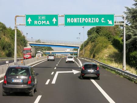 street signs: Traffic on Italian Autostrada highway, motorway near Rome in Lazio, Italy