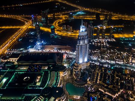 nightfall: Aerial night view from Burj Khalifa of the Address Downtown Dubai skyscraper, Dubai Mall, Old Town Island and Sheikh Zayed Road in downtown Dubai, United Arab Emirates