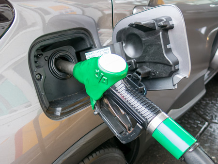 unleaded: Close-up of unleaded gas pump nozzle  refilling the car in petrol station in the Netherlands Stock Photo