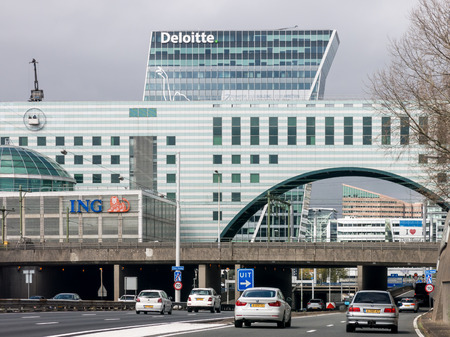 Traffic on motorway A12 also called Utrechtsebaan,  and modern buildings in The Hague, Netherlands 報道画像