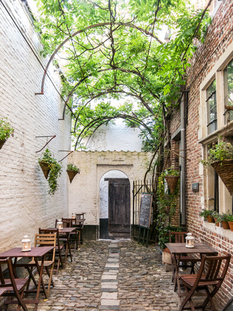 flanders: Small medieval alley called Vlaeykensgang in the city centre of Antwerp in Flanders, Belgium Editorial