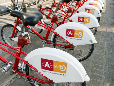 flanders: Bicycles for rent in a row in the city centre of Antwerp, Flanders, Belgium Editorial