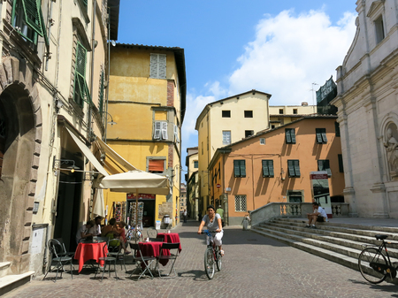 streetscene: Bicyclist and street scene in Lucca, Tuscany, Italy Editorial
