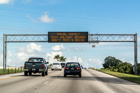 panel: Electronic variable message board on matrix billboard on highway in Florida warning drivers not to text and drive